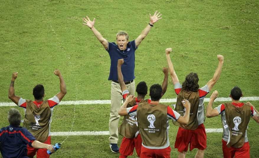 United States' head coach Juergen Klinsmann celebrates after his team won 2-1 during the group G World Cup soccer match between Ghana and the United States at the Arena das Dunas in Natal, Brazil, Monday, June 16, 2014. (AP Photo/Hassan Ammar)