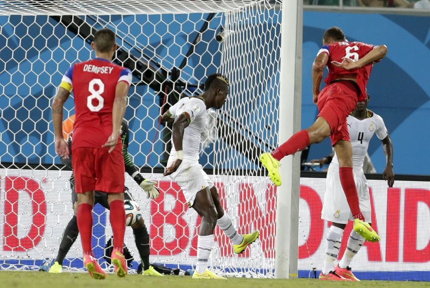 United States' John Brooks, right, scores his side's second goal during the group G World Cup soccer match between Ghana and the United States at the Arena das Dunas in Natal, Brazil, Monday, June 16, 2014.   (AP Photo/Dolores Ochoa)