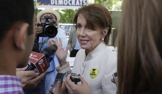 House Minority Leader Nancy Pelosi talks with reporters after attending the opening of the new California Democratic Party headquarters in Sacramento, Calif., Monday, June 16, 2014.  Pelosi called for minimal military involvement in Iraq and praised California for passing a timely budget.(AP Photo/Rich Pedroncelli)