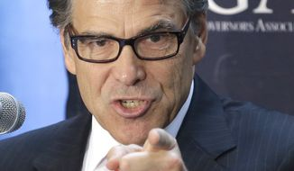 Texas Gov. Rick Perry makes a point during a press conference about Environmental Protection Agency regulations Monday, June 16, 2014, in Houston. Perry hosted Wyoming Gov. Matt Mead, Louisiana Gov. Bobby Jindal and North Dakota Gov. Jack Dalrymple to say new EPA rules designed to cut global warming pollution from power plants by 30 percent by 2030 will kill jobs and growth. (AP Photo/Pat Sullivan)