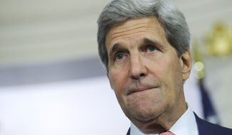 ** FILE ** Secretary of State John Kerry pauses while speaking during a media availability with Chilean Foreign Minister Heraldo Munoz at the State Department in Washington, Monday, June 16, 2014. (AP Photo/Susan Walsh)