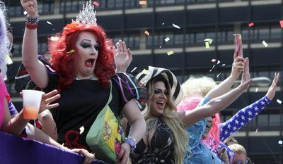 Drag queens wave to spectators during the annual Pride Day Parade, Sunday June 8, 2014, in Philadelphia. (AP Photo/ Joseph Kaczmarek)