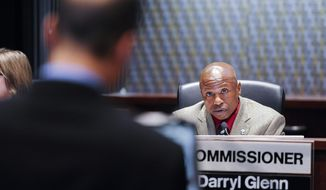 El Paso County Commissioner Darryl Glenn addresses Sheriff Terry Maketa at a Board of County Commissioners meeting at Centennial Hall in Colorado Springs, Colo., on June 17, 2014. (Associated Press/The Colorado Springs Gazette, Michael Ciaglo) **FILE**