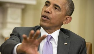 **FILE** President Barack Obama speaks in the Oval Office of the White House on June 12, 2014. (Associated Press)