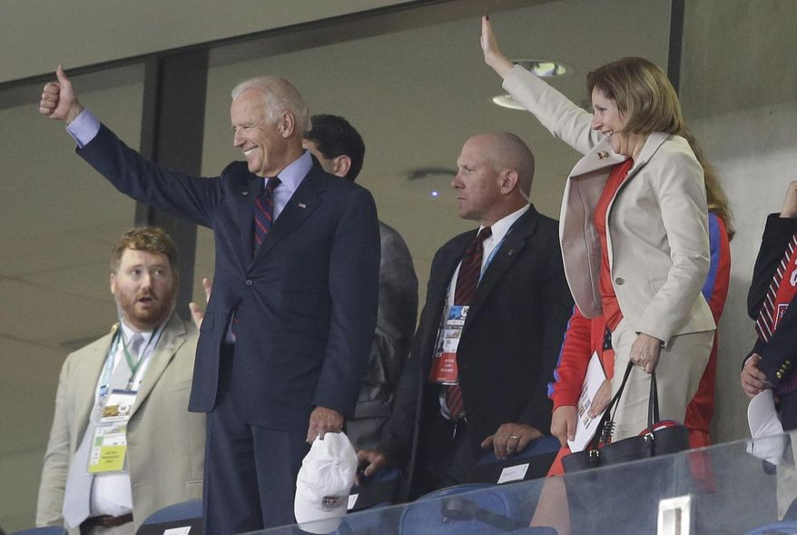 ** FILE ** U.S. Vice President Joe Biden, left, gives a thumbs-up after the group G World Cup soccer match between Ghana and the United States at the Arena das Dunas in Natal, Brazil, Monday, June 16, 2014. The United States won the match 2-1. (AP Photo/Ricardo Mazalan)