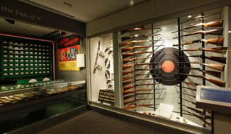 A tour through the National Firearms Museum in Fairfax, Virginia (above) will show many hidden gems such as engraved Italian shotguns, American rifles and German handguns. Enclosed in a small ebony coffin (left) is a silver-plated, snub-nosed revolver covered with etchings of bats and housed with a vial of holy water, wooden stake and tiny vampire skulls. (National Firearms Museum Photographs)