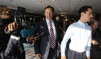 Republican 7th District congressional candidate Dave Brat, center, leaves a Rotary Club breakfast in Richmond, Va., Tuesday, June 17, 2014.  Brat defeated House Majority Leader Eric Cantor in last week's Republican primary. (AP Photo/Steve Helber)