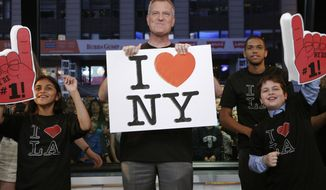 """** FILE ** In this photo provided by the American Broadcasting Co., New York Mayor Bill de Blasio, center, appears on the Jimmy Kimmel Live show, Monday, June 16, 2014, in New York. The mayor of New York City sang """"I Love L.A"""" on """"Jimmy Kimmel Live"""" Monday night to settle a Stanley Cup wager with Los Angeles Mayor Eric Garcetti.  (AP Photo/Heidi Gutman, ABC)"""