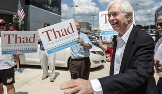 U.S. Sen. Thad Cochran, R-Miss., greets supporters as he makes a campaign stop in McComb, Miss., Tuesday, June 17, 2014. Age is a factor in the June 24 Republican primary runoff between Cochran and state Sen. Chris McDaniel, a tea party-backed candidate. (AP Photo/The Enterprise-Journal, Daniel Lin)
