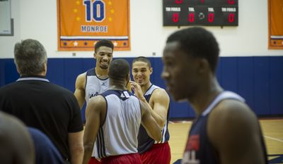Nick Johnson (second from right) chats with Khem Birch (second from left) and Deonte Burton (third from left with back to camera) after the Washington Wizards held a pre-draft workout at the Verizon Center in Washington, DC, Tuesday, June 17, 2014. (Photo Rod Lamkey Jr.)
