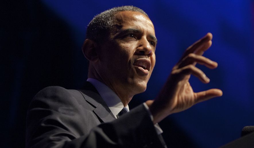 President Barack Obama speaks at the Democratic National Committee's annual Lesbian, Gay, Bisexual and Transgender (LGBT) fundraiser gala in New York's Gotham Hall on June 17, 2014. (Associated Press) **FILE**