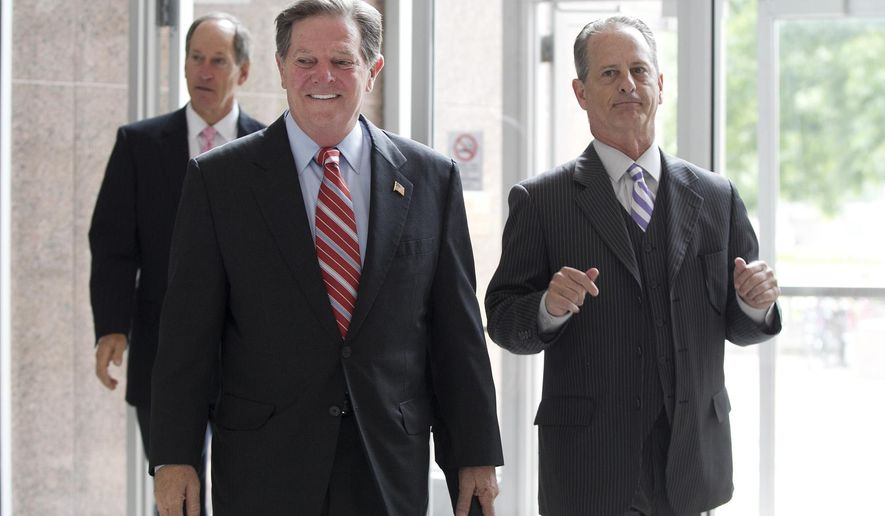 Tom Delay, left, arrives at the Texas Court of Criminal Appeals in Austin, on Wednesday, June 18, 2014. Prosecutors have prepared their case to present to the highest Texas criminal court in support of reinstating the convictions of DeLay. DeLay was convicted in 2010 of money laundering and conspiracy to commit money laundering for participating in a scheme to influence Texas elections. But a lower appeals court ruled last year that prosecutors failed to prove their case and vacated DeLay's convictions.  (AP Photo/Austin American-Statesman, Dborah Cannon)  AUSTIN CHRONICLE OUT, COMMUNITY IMPACT OUT, INTERNET AND TV MUST CREDIT PHOTOGRAPHER AND STATESMAN.COM, MAGS OUT