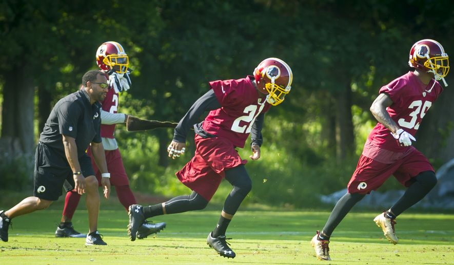 Washington Redskins safety Ryan Clark (21) takes part in a drill on the practice field during mini camp practice at Redskins Park in Ashburn, Va., Wednesday, June 18, 20124. (Photo Rod Lamkey Jr.)