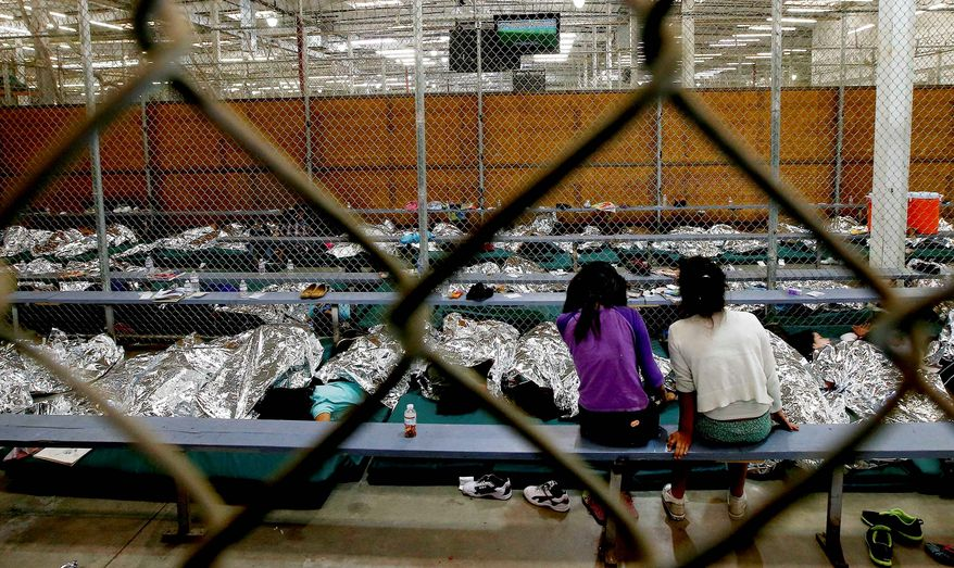 Entertainment: Girls watch a World Cup soccer match on television from their holding area in Nogales, Arizona. U.S. Customs and Border Protection has processed more than 47,000 unaccompanied children, mostly from Central America, who have entered the country. (Associated Press photographs)