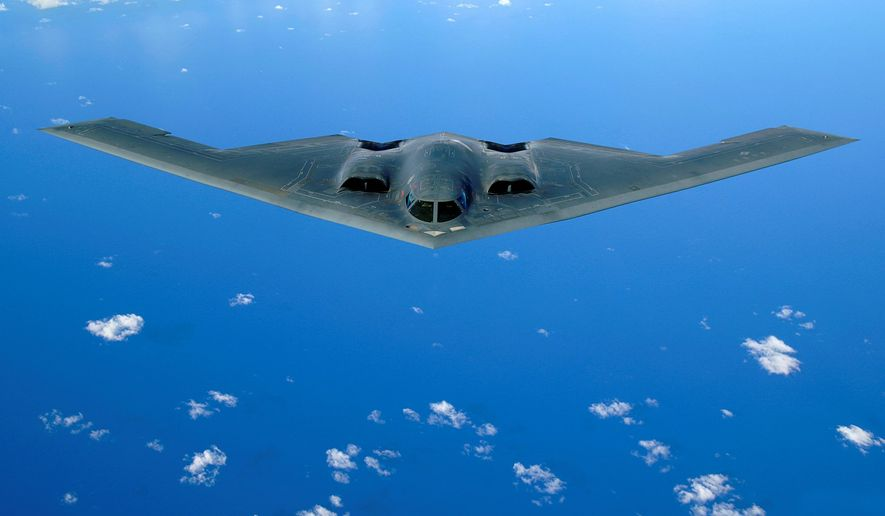 This image provided by the U.S. Air Force shows a B-2 stealth bomber flying over the Pacific Ocean, before arriving at Andersen Air Force Base, Guam,  in 2006. A B-2 stealth bomber crashed Saturday Feb. 23, 2008 at Anderson Air Force Base in Guam. The two pilots aboard the bomber ejected before the crash and are safe the U.S. Air Force said. A board of Air Force officers will investigate what happened. Each B-2 bomber costs about $1.2 billion to build. All 21 stealth bombers are based at Whiteman Air Force Base in Missouri, but the Air Force has been rotating several of them through Guam since 2004, along with B-1 and B-52 bombers. (AP Photo/U.S. Air Force photo, Staff Sgt. Bennie J. Davis III)