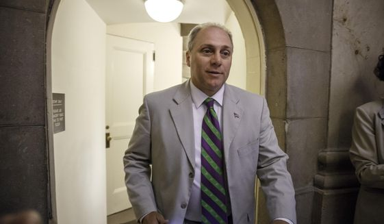 FILE - This June 11, 2014, file photo shows Rep. Steve Scalise, R-La., walking through a staircase at the Capitol in Washington. The contest for the No. 3 spot in the House GOP has turned into tea party conservatives' last, best shot at congressional leadership after getting shut out of the top two jobs in the shakeup following Majority Leader Eric Cantor's surprise primary defeat. All three _ Scalise of Louisiana, Peter Roskam of Illinois, and Marlin Stutzman _ are to make their case to GOP rank-and-file lawmakers Wednesday ahead of votes on Thursday. (AP Photo/J. Scott Applewhite)