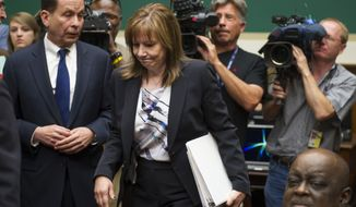 General Motors CEO Mary Barra walks past former US Attorney Anton Valukas, investigator , Jenner & Block, left, and television cameras as she arrives on Capitol Hill in Washington, Wednesday, June 18, 2014, to testify before the House Oversight and Investigations subcommittee hearing examining the facts and circumstances that contributed to General Motors' failure to identify a safety defect in certain ignition switches and initiate a recall in a timely manner. (AP Photo/Cliff Owen)