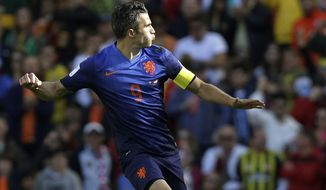 Netherlands' Robin van Persie celebrates after scoring his side's second goal during the group B World Cup soccer match between Australia and the Netherlands at the Estadio Beira-Rio in Porto Alegre, Brazil, Wednesday, June 18, 2014.  (AP Photo/Fernando Vergara)