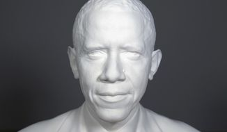 This undated handout image provided by the Smithsonian Institution shows  the first presidential portrait created from 3-D scan data. A team at the Smithsonian Institution has created the first 3D presidential portraits to depict President Barack Obama in the National Portrait Gallery collection. Digital imaging specialists have created a 3D printed bust and life mask of Obama. Both were shown for the first time Wednesday at the first ever White House Maker Faire with a gathering of inventors and students. (AP Photo/Smithsonian Institution)