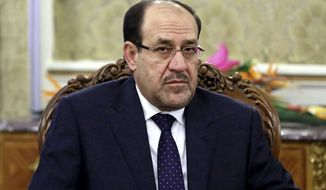 """FILE - In this Thursday, Dec. 5, 2013 file photo, Iraqi Prime Minister Nouri al-Maliki meets with Iran's former President Akbar Hashemi Rafsanjani in Tehran, Iran. Iraqi security forces battled insurgents targeting the country's main oil refinery and claimed to regain partial control of a city near the Syrian border Wednesday, trying to blunt a weeklong offensive by militants who diplomats fear may have abducted some 100 foreign workers. Al-Maliki, meanwhile, struck an optimistic tone after soldiers abandoned their posts in the wake of the initial offensive, promising his nation would teach the attackers a """"lesson."""" """"We have now started our counteroffensive, regaining the initiative and striking back,"""" al-Maliki said. (AP Photo/Ebrahim Noroozi, File)"""