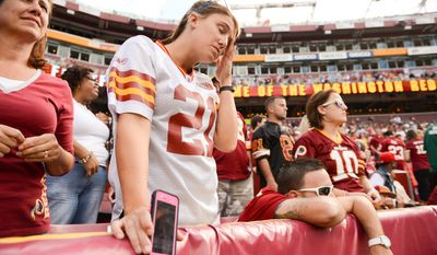 Kayla Fitzgerald of Annapolis, Md. shows her frustration as in the closing minutes of the game as the Washington Redskins lose to the Detroit Lions 27-20 in NFL football at FedExField, Landover, Md., Monday, September 9, 2013. (Andrew Harnik/The Washington Times)
