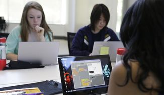 In this photo taken Wednesday, June 18, 2014, a group of high school girls work at completing an exercise during a Girls Who Code class at Adobe Systems in San Jose, Calif. (AP Photo/Eric Risberg)