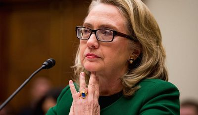 ** FILE ** Then-Secretary of State Hillary Clinton testifies before the House Committee on Foreign Affairs on the Sept. 11, 2012, attacks against the U.S. diplomatic facilities in Benghazi. (Andrew Harnik/The Washington Times)