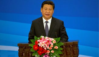 """Since Xi Jinping became supreme leader in late 2012, China has shifted into overdrive with a campaign to strengthen the ideological purity of the Communist Party, as well as establish an overarching """"national security"""" state. (AP Photo/Ng Han Guan)"""