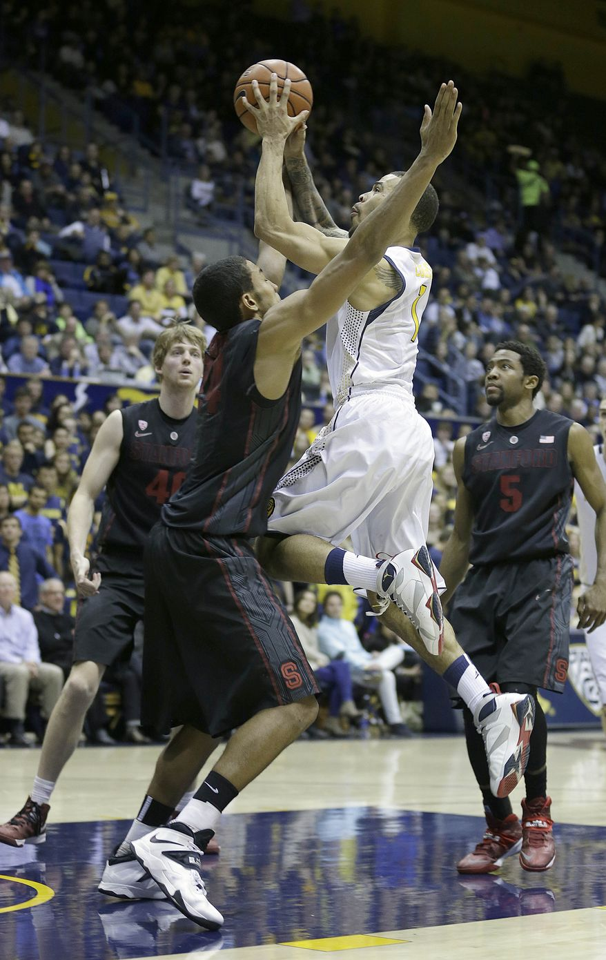 California guard Justin Cobbs (1) goes to the basket as Stanford forward Josh Huestis (24) defends during the second half of an NCAA college basketball game, Wednesday, Feb. 5, 2014, in Berkeley, Calif. Stanford won 80-69. (AP Photo/Tony Avelar)