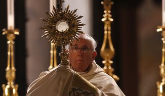 Pope Francis holds a monstrance containing the Eucharist at the end of the Corpus Domini procession from St. John at the Lateran Basilica to St. Mary Major Basilica to mark the feast of the Body and Blood of Christ, in Rome, Thursday, June 19, 2014. (AP Photo/Riccardo De Luca)