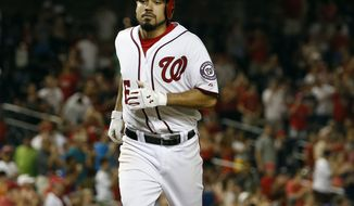 Washington Nationals' Anthony Rendon heads to home for his solo home run during the seventh inning of an interleague baseball game against the Houston Astros at Nationals Park Wednesday, June 18, 2014, in Washington. The Nationals won 6-5. (AP Photo/Alex Brandon)