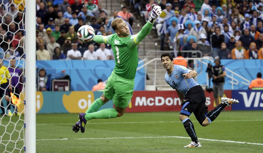 England's goalkeeper Joe Hart can't stop Uruguay's Luis Suarez's header to score his side's first goal during the group D World Cup soccer match between Uruguay and England at the Itaquerao Stadium in Sao Paulo, Brazil, Thursday, June 19, 2014.  (AP Photo/Felipe Dana)