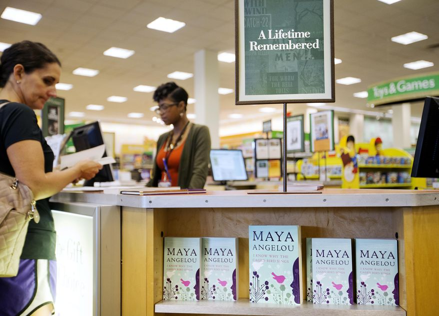 "Maya Angelou's autobiographical ""I Know Why the Caged Bird Sings"" (shown on display at a Barnes & Noble store in Atlanta) was ""about voice, about finding it and using it,"" says educator Thelma Reese. (AP Photo/David Goldman)"