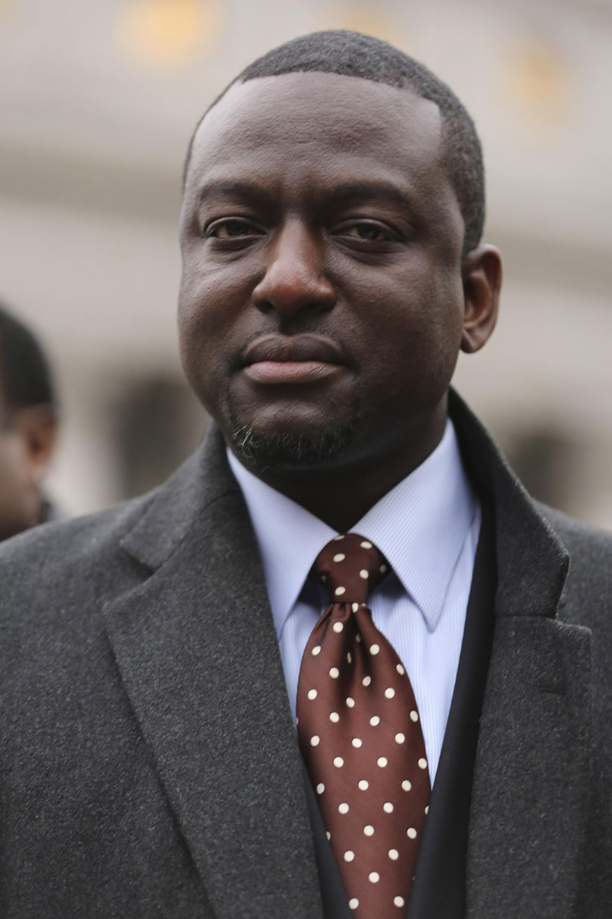 FILE - In this Jan. 17, 2013 file photo, Yusef Salaam is photographed during a rally outside Federal court in New York.  A city official said Friday, June 20, 2014 that New York City has agreed to a $40 million settlement in a civil rights lawsuit filed against police and prosecutors by Salaam and four co-defendants exonerated in the notorious case of a jogger attacked in Central Park in 1989.(AP Photo/Mary Altaffer, File)