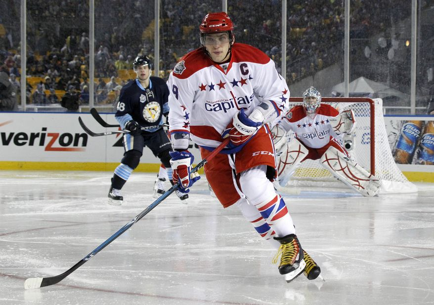 Washington Capitals' Alex Ovechkin (8) plays in the NHL Winter Classic hockey game between the Pittsburgh Penguins and the Washington Capitals in Pittsburgh, Saturday, Jan. 1, 2011 . (AP Photo/Keith Srakocic)