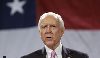 Sen. Orrin Hatch, Utah Republican, addresses a crowd during the Utah Republican Party nominating convention, in Sandy, Utah, on April 26, 2014. (Associated Press) **FILE**