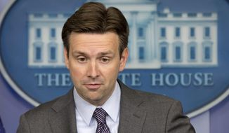 White House press secretary Josh Earnest. (Associated Press) ** FILE **