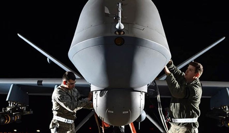 U.S. airmen prepare an MQ-9 Reaper for flight during exercise Combat Hammer, May 15, 2014, at Creech Air Force Base, Nev. (U.S. Air Force)