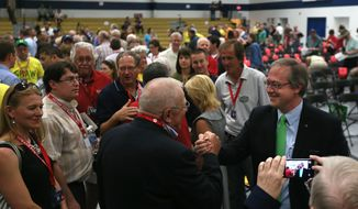 People congratulate David Young, right, after he received the Republican nomination in Iowa's 3rd Congressional District for the U.S. House during a special convention on Saturday, June 21, 2014, in Urbandale, Iowa. Establishment Republicans are hoping to hold the seat in the swing-voting district that includes Des Moines and rural southwest Iowa. (AP Photo/The Des Moines Register, Mary Willie)  MAGS OUT, TV OUT, NO SALES, MANDATORY CREDIT