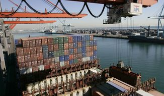 **FILE** Cargo is unloaded from the APL Singapore vessel at the port of Los Angeles on Dec. 4, 2006. (Associated Press)