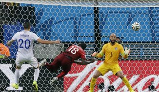 Portugal's Silvestre Varela heads the ball past United States' goalkeeper Tim Howard to score his side's second goal and tie the game 2-2 during the group G World Cup soccer match between the USA and Portugal at the Arena da Amazonia in Manaus, Brazil, Sunday, June 22, 2014. (AP Photo/Martin Mejia)
