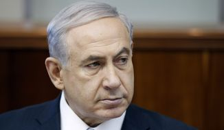 Israel's Prime Minister Benjamin Netanyahu attends the weekly cabinet meeting at his office in Jerusalem Sunday, June 22, 2014. Israel's military says troops have shot dead one Palestinian, and a Palestinian medical official says another was killed, as the army searches for three missing teens and looks to dismantle the Islamic militant group Hamas. Meanwhile the military says a civilian vehicle has exploded near the Syrian frontier in the Golan Heights, and that there are several casualties. (AP Photo/Baz Ratner, Pool)