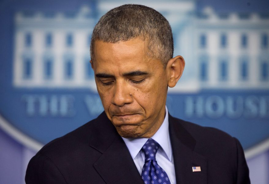 ** FILE ** This June 19, 2014, file photo shows President Barack Obama pausing as he talks about the situation in Iraq. (AP Photo/Pablo Martinez Monsivais, File)