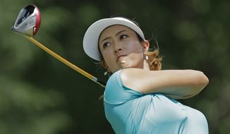 Michelle Wie watches her tee shot on the seventh hole during the final round of the U.S. Women's Open golf tournament in Pinehurst, N.C., Sunday, June 22, 2014. (AP Photo/Bob Leverone)