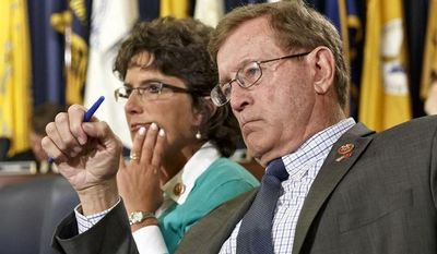 Rep. Paul Cook, R-Calif., right, and Rep. Jackie Walorski, R-Ind., members of the House Committee on Veterans' Affairs, listen as officials from the the Department of Veterans Affairs testify about allegations of gross mismanagement and misconduct at Veterans Administration hospitals, possibly leading to patient deaths, on Capitol Hill in Washington, Wednesday, May 28, 2014. (AP Photo/J. Scott Applewhite)