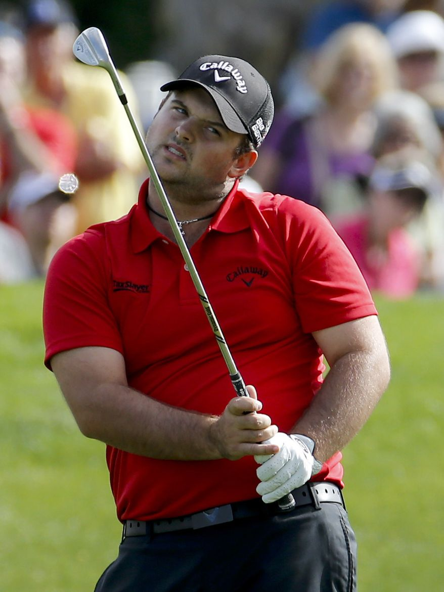 Patrick Reed watches his chip to the fifth green during the final round of the Humana Challenge golf tournament on the Palmer Private course at PGA West, Sunday, Jan. 19, 2014, in La Quinta, Calif. (AP Photo/Matt York)