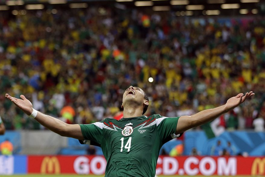 Mexico's Javier Hernandez celebrates after scoring his teams third goal during the group A World Cup soccer match between Croatia and Mexico at the Arena Pernambuco in Recife, Brazil, Monday, June 23, 2014. (AP Photo/Ricardo Mazalan)