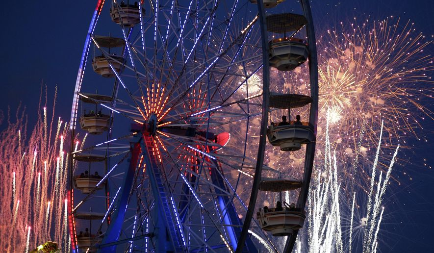 Fireworks explode over the Electric Daisy Carnival, Friday, June 20, 2014, in Las Vegas. Fireworks and rides, including 5 Ferris wheels, add to the carnival atmosphere of the electronic dance music festival. (AP Photo/John Locher)