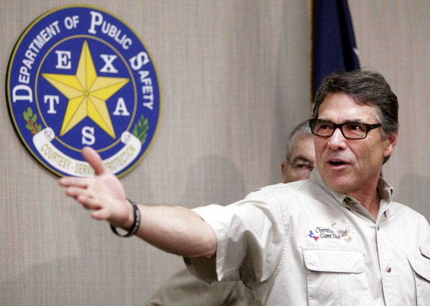 "Texas Gov. Rick Perry talks to the media after touring the McAllen Border Patrol station, Monday June 23, 2014, at the Texas Department of Public Safety regional headquarters in Weslaco, Texas. Perry said the number of immigrants being arrested has created an ""untenable situation."" (AP Photo/The Monitor, Gabe Hernandez)"