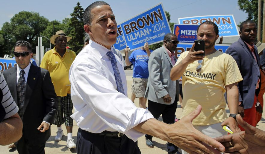 Maryland Democratic gubernatorial candidate, Lt. Gov. Anthony Brown, shakes hands with supporters outside a polling place at Hazelwood Elementary/Middle School on primary day in Baltimore on Tuesday, June 24, 2014. (AP Photo/Patrick Semansky) ** FILE **